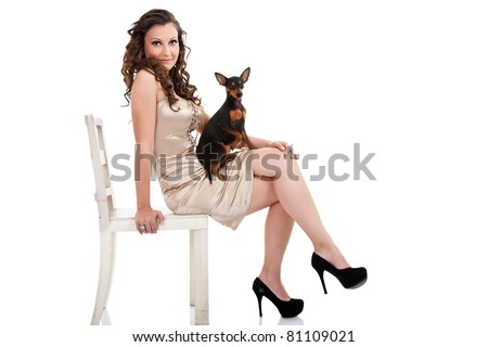 attractive  young fashion woman with dog in lap, isolated on white background - stock photo