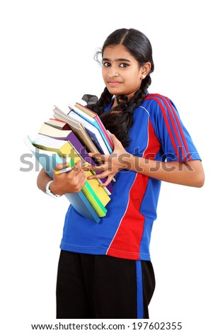 Attractive young female college student carrying a stack of books. shot in studio - stock photo