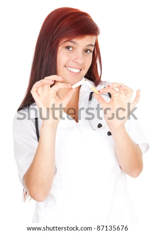 attractive young female doctor in lab coat holding a cigarette broken in half - stock photo