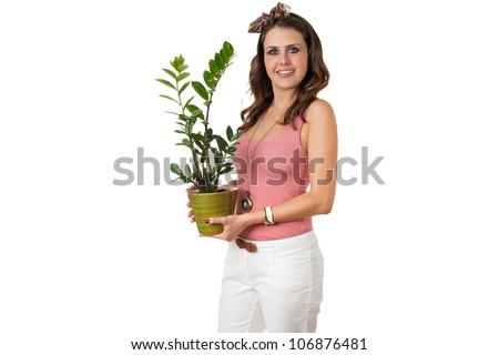 attractive young female holding a plant isolated on white