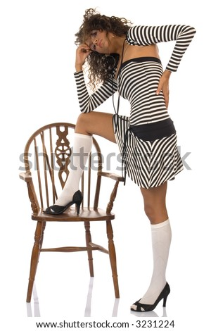 Attractive young female model posing with wooden chair isolated on white background