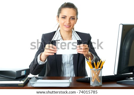attractive young female office worker holds empty, blank card in front of her, isolated on white background