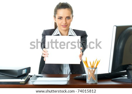 attractive young female office worker holds empty white card in front of her, isolated on white - stock photo