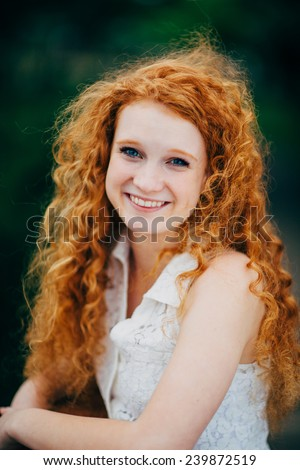 Attractive Young Female Redhead, curly hair smile - stock photo