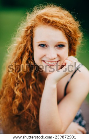 Attractive Young Female Redhead, smiling, hand under chin, vertical, variation close up - stock photo