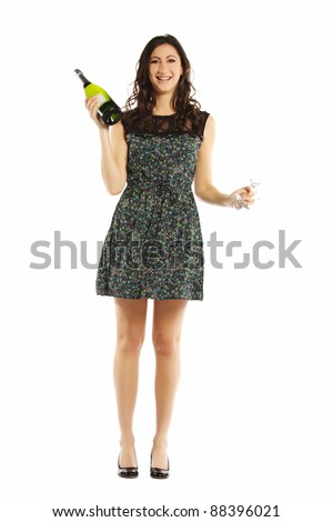 Attractive young female standing with wine on white - stock photo