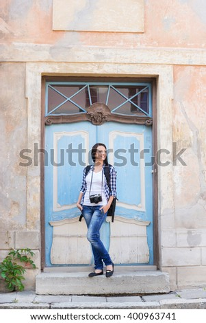 Attractive young female tourist near the old building. - stock photo
