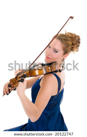 Attractive young female violinist holding violin and bow. Evening dress.  Studio shot, white background.