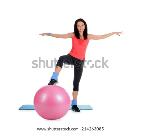 Attractive young female with fitness ball in sport center - stock photo