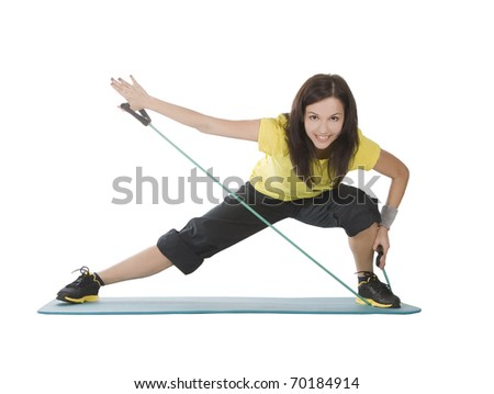 Attractive young female with fitness expander in stretching - stock photo