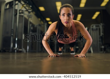 Attractive young female working out at the gym