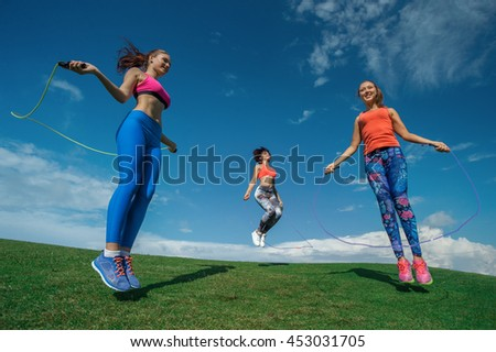 Attractive Young Fitness Women Exercising Jumping Rope  - stock photo