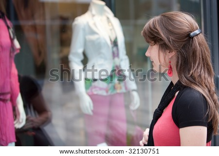 Attractive young girl checking out the window display