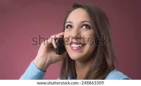 Attractive young girl having a phone call with a mobile phone - stock photo