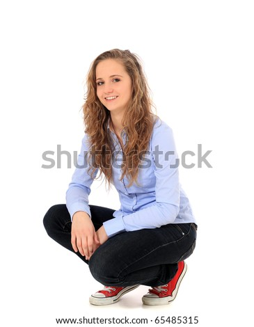 Attractive young girl in squatting position. All on white background. - stock photo