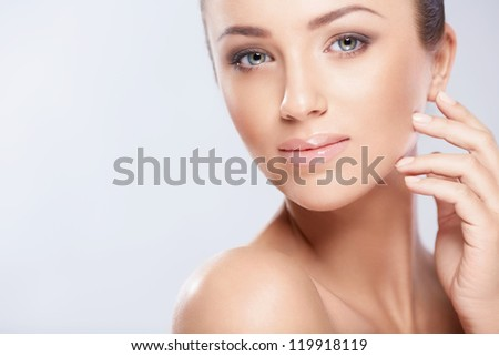 Attractive young girl in studio - stock photo