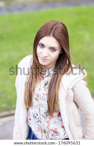 Attractive young girl in the park.