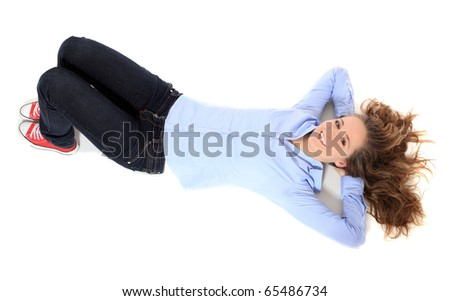 Attractive young girl lying on the floor. All on white background.