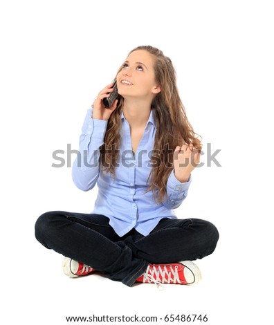 Attractive young girl making a phone call. All on white background. - stock photo