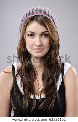 Attractive young girl poses for a portrait in studio - stock photo