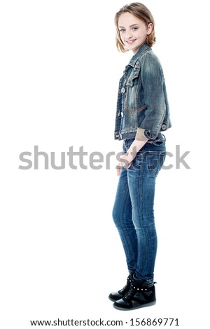 Attractive young girl posing in trendy casuals - stock photo