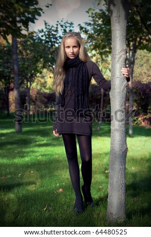 Attractive young girl posing outdoor in garden