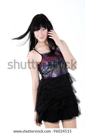attractive young girl standing in studio