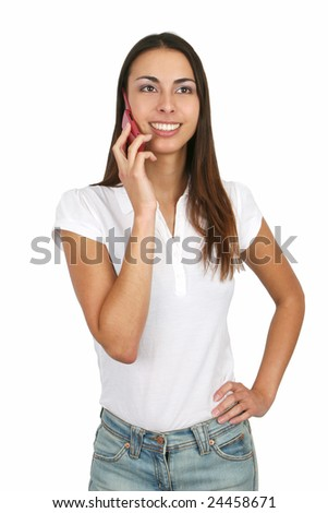 Attractive young girl talking on a cell phone. Isolated on white. - stock photo