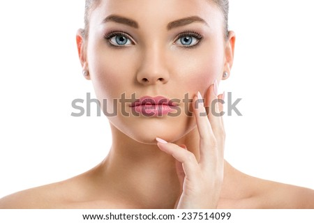 Attractive young girl touching her  healthy skin - stock photo