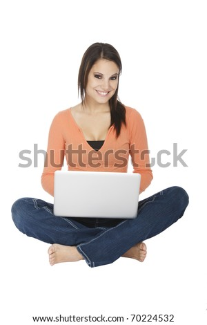 Attractive young girl using notebook computer on white background.