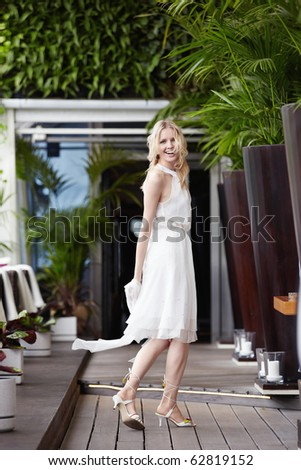Attractive young girl wearing a dress indoors - stock photo