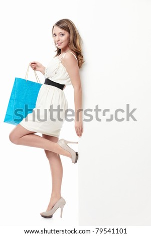 Attractive young girl with a bag - stock photo
