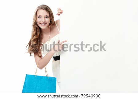 Attractive young girl with a bag, and billboards - stock photo