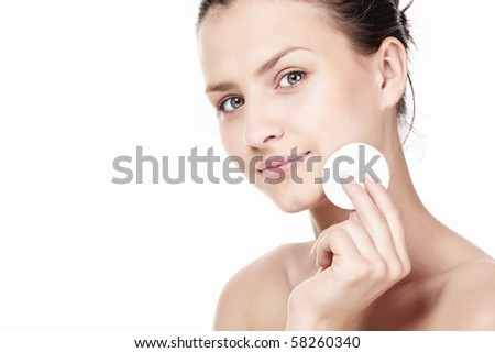 Attractive young girl with a cotton disc - stock photo