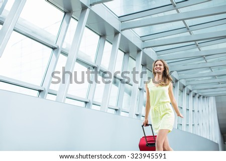 Attractive young girl with a suitcase - stock photo