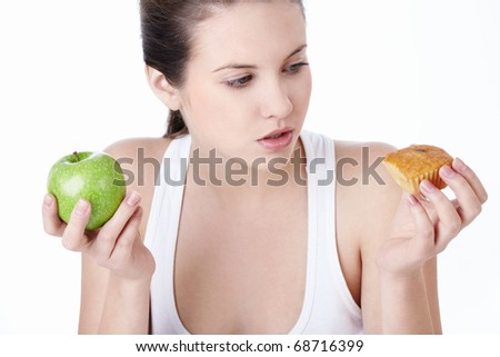 Attractive young girl with an apple and a cake isolated - stock photo