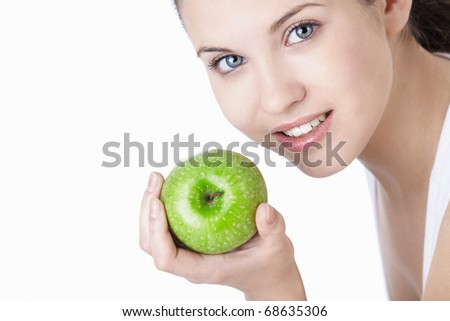 Attractive young girl with an apple isolated - stock photo