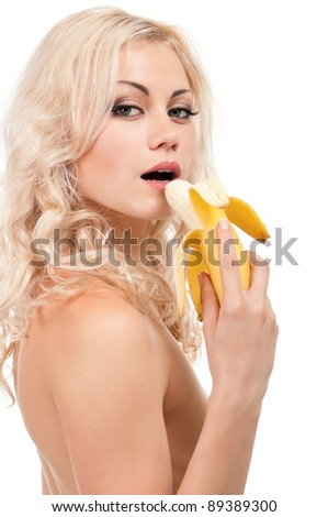 Attractive young girl with banana - isolated on white background - stock photo