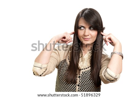 Attractive young girl with fingers in ear not listening isolated on white - stock photo