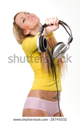 Attractive young girl with headphones over white background