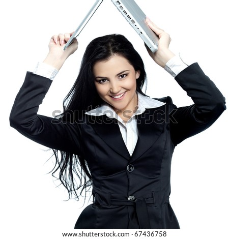 attractive young girl with laptop smiling - stock photo