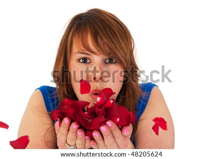 Attractive young girl with red roses and red hair