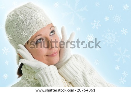 attractive young girl with snowflakes in the background