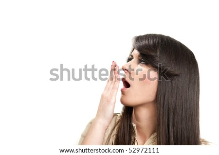 Attractive young girl yawning with hand in front of mouth - stock photo
