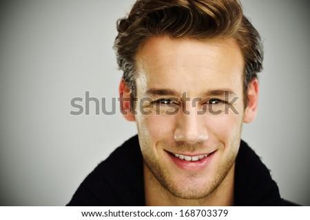 Attractive young guy posing in studio - stock photo