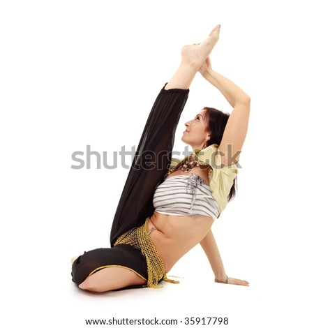 Attractive young gymnast isolated on a white background with copy space