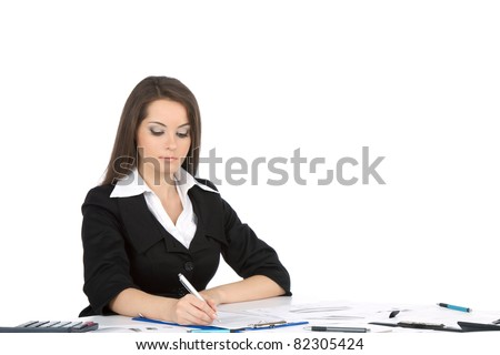 Attractive young happy businesswoman in elegant suits sitting at the table, desk, working with documents, write, sign up contract, looking at papers, business plan. isolated over white background - stock photo