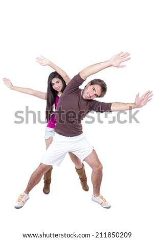 Attractive young happy couple excercising stretching isolated on white - stock photo