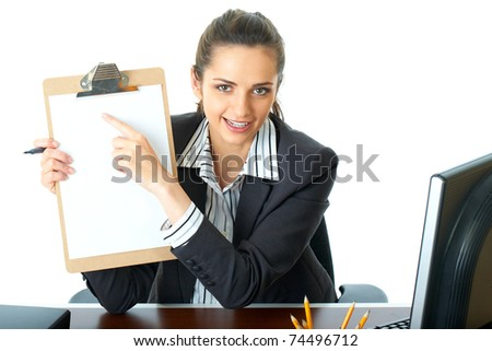 attractive young happy female office worker holds wooden board with blank A4 card, point with her finger, isolated on white background