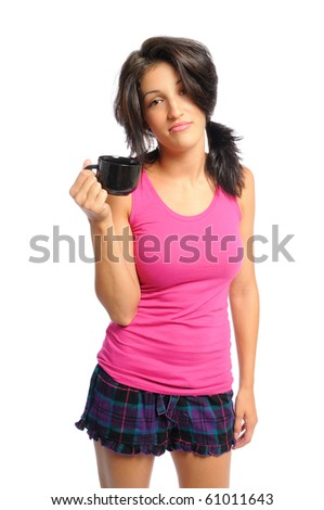 attractive young hispanic woman in PJ's with her morning coffee on a white background